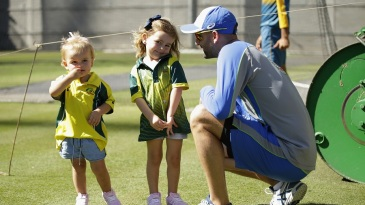 Nathan Lyon takes a break from training to spend time with his children