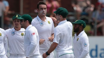 Kyle Abbott is mobbed by team-mates after picking up an early wicket