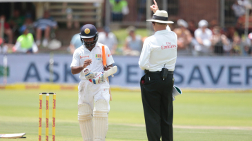 Kaushal Silva walks back after an unsuccessful review