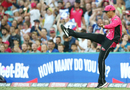 Johan Botha kicks the ball away after taking a catch, Sydney Sixers v Perth Scorchers, Big Bash League, Sydney, December 27, 2016