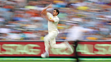 Mitchell Starc steams in at the MCG