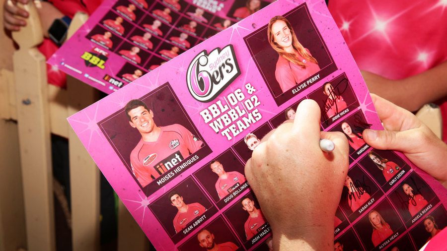 Sydney Sixers players sign autographs for fans