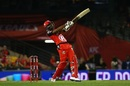 Dwayne Bravo launches into a shot, Renegades v Scorchers, Big Bash League, Melbourne, December 29, 2016