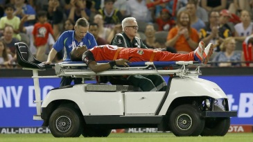 Dwayne Bravo was stretchered off the field after jarring his foot near the boundary