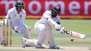 Dimuth Karunaratne plays a sweep