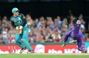 Jimmy Peirson takes off the bails as George Bailey is caught short of his crease, Brisbane Heat v Hobart Hurricanes, Big Bash League 2016-17. Brisbane, December 30, 2016