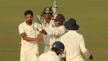 Shahbaz Nadeem took three of Gujarat's four wickets