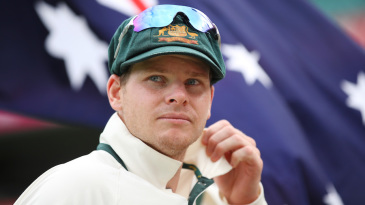 Steven Smith leads his team out