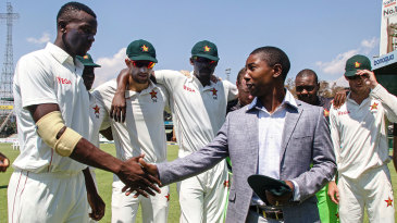 Fast bowler Carl Mumba receives his Zimbabwe Test cap from former captain Tatenda Taibu