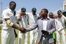Fast bowler Carl Mumba receives his Zimbabwe Test cap from former captain Tatenda Taibu, Zimbabwe v Sri Lanka, 1st Test, Harare, 1st day, October 29, 2016