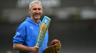Jason Gillespie runs a drill prior to the start of the match