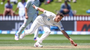 Trent Boult moves to his left to field off his own bowling