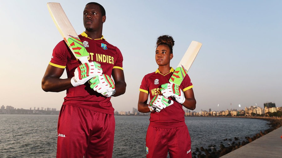 Carlos Brathwaite and Hayley Matthews pose for photographs by the sea in Mumbai