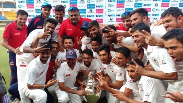The Gujarat players pose with their maiden Ranji Trophy title