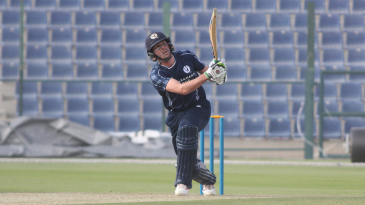 Calum MacLeod heaves his third six over midwicket to reach a half-century