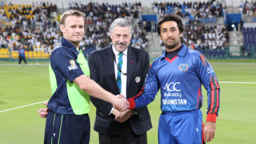 Ireland's William Porterfield and Afghanistan's Asghar Stanikzai shake hands after the toss