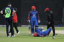 Najeeb Tarakai receives treatment after being hit by a throw, Afghanistan v Ireland, Desert T20, Group A, Abu Dhabi, January 14, 2017