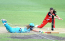 Haidee Birkett dives as Molly Strano attempts to breaks the stumps, Brisbane Heat v Melbourne Renegades, Women's Big Bash League, Allan Border Field, Brisbane, January 15, 2017