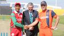 Oman's Sultan Ahmed and Netherlands' Peter Borren shake hands at the toss, Netherlands v Oman, Desert T20, Group B, Abu Dhabi, January 15, 2017