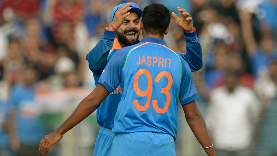 Virat Kohli celebrates with Jasprit Bumrah