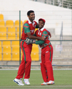 Kaleemullah celebrates the wicket of Michael Rippon with wicketkeeper-captain Sultan Ahmed, Netherlands v Oman, Desert T20, Group B, Abu Dhabi, January 15, 2017