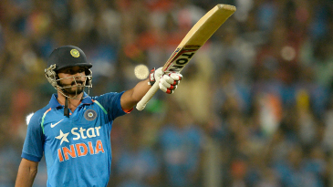 Kedar Jadhav celebrates a century in front of his home crowd