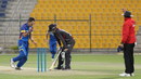 Colin Peake pumps his fist after deflecting the ball onto the stumps in his follow-through to run out Rohan Mustafa, UAE v Namibia, Desert T20, Group A, Abu Dhabi, January 15, 2017