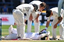 New Zealand players check on Mushfiqur Rahim after he was hit on the head, New Zealand v Bangladesh, 1st Test, Wellington, 5th day, January 16, 2017
