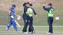 Craig Young gets a pat on the head from William Porterfield after dismissing Louis van der Westhuizen, Ireland v Namibia, Desert T20, Group A, Abu Dhabi, January 17, 2017