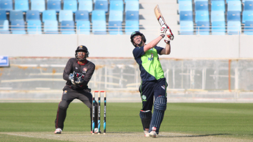 Kevin O'Brien looks to the sky after driving Ahmed Raza for six over long-off