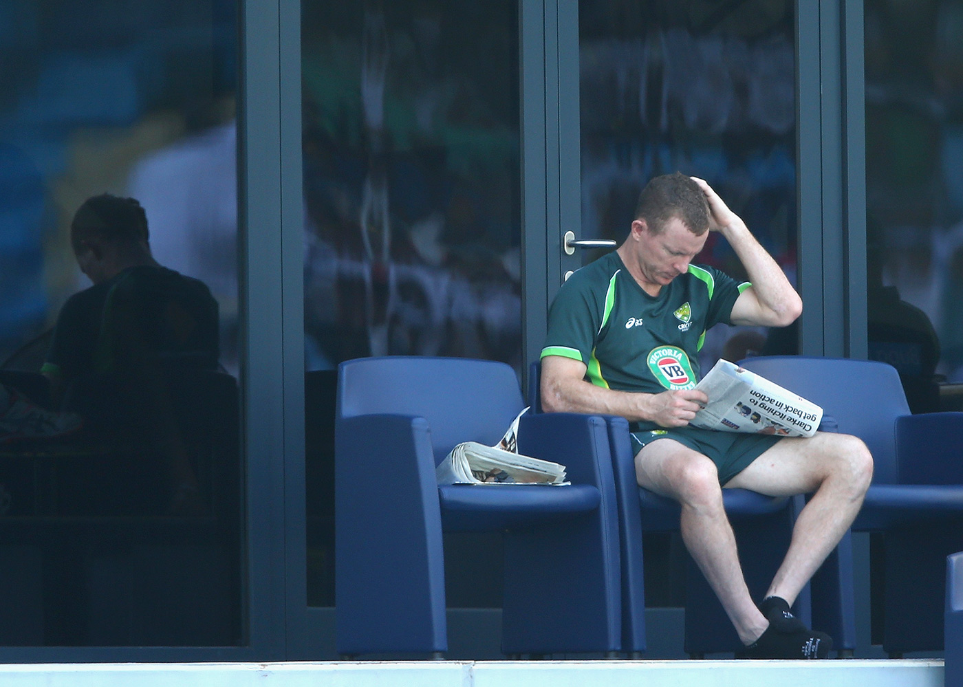 Chris Rogers reads the newspaper