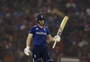 Eoin Morgan raises his bat after reaching fifty, India v England, 2nd ODI, Cuttack, January 19, 2017
