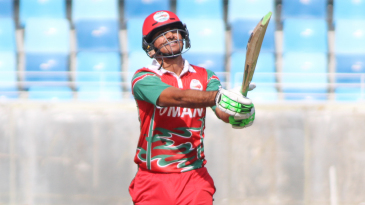 Naseem Khushi holds his pose after clocking Dawlat Zadran for six over midwicket
