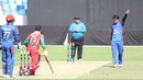Rashid Khan points Khurram Khan back to the dugout after bowling him for 24, Afghanistan v Oman, Desert T20, 1st semi-final, Dubai, January 20, 2017
