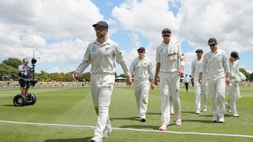 Kane Williamson leads his team off