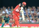 Marcus Harris lofts one down the ground, Brisbane Heat v Melbourne Renegades, BBL 2016-17, Brisbane, January 20, 2017
