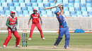Asghar Stanikzai clubs a six down the ground off Khawar Ali during his unbeaten 25, Afghanistan v Oman, Desert T20, 1st semi-final, Dubai, January 20, 2017