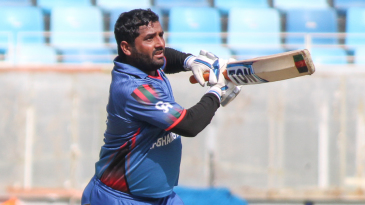 Mohammad Shahzad scoops a single down the ground during his 80