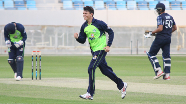 Jacob Mulder celebrates after removing Kyle Coetzer for his third wicket in a spell of 4 for 16