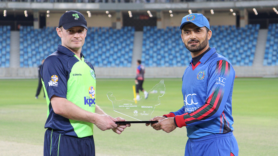William Porterfield and Nawroz Mangal hold the tournament trophy ahead of the inaugural final