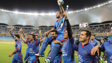 Team-mates carry Nawroz Mangal on a victory lap