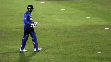 Angelo Mathews walks back after being dismissed for six
