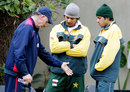 India coach Greg Chappell talks to Mohammad Wasim and Mansoor Amjad, Lahore, January 9, 2006
