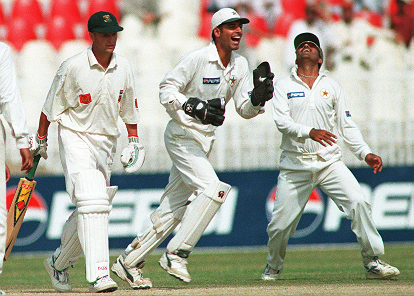 Wasim, as a substitute keeper for Moin Khan, celebrates the dismissal of Gary Kirsten in Rawalpindi, 1997-98