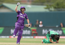 Corinne Hall runs off to celebrate while Gemma Triscari is shattered, Hobart Hurricanes v Melbourne Stars, Women's Big Bash League 2016-17, Hobart