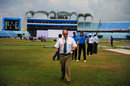Match referee Andy Pycroft leaves the ground after inspecting the outfield, Bangladesh v West Indies, first Test, day three, Chittagong, October 23, 2011