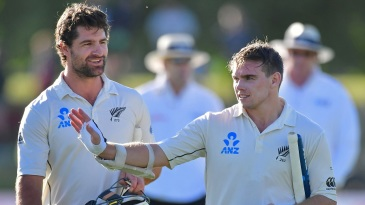Colin de Grandhomme and Tom Latham walk back after securing a nine-wicket win