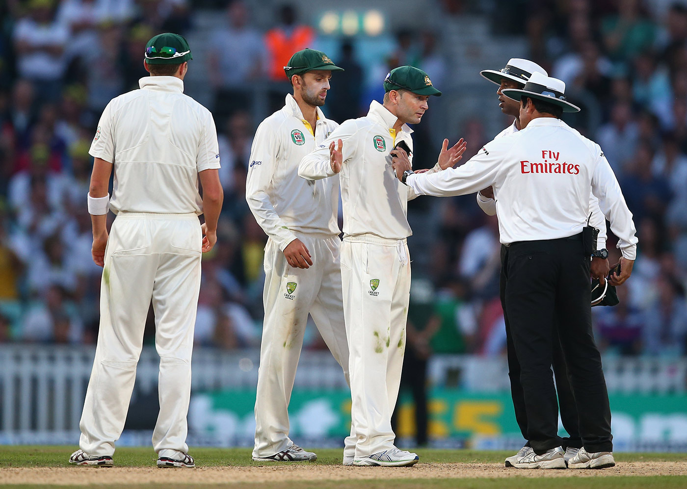 Michael Clarke in an animated discussion with the umpires