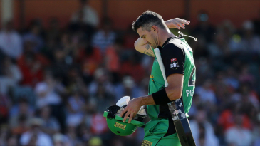 Kevin Pietersen unhooks the mic as he walks back to the dugout