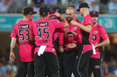 Nathan Lyon is mobbed by team-mates after taking a wicket, Brisbane Heat v Sydney Sixers, Big Bash League 2016-17, semi-final, Brisbane, January 25, 2017